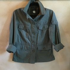 """J Crew Utility jacket J crew olive green utility jacket from 2014.  Worn a couple times.  In great shape!!!!  Button front , 5 pockets,  bottom has double pockets on bottom and back vents.  Button cuffs and Partial lining. Length 21"""".  I believe this is from j crew factory. J. Crew Jackets & Coats Utility Jackets"""