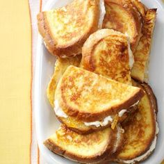 Marmalade French Toast Sandwiches Recipe -I change up these warm, filling sandwiches to be sweet or savory but always a treat. All it takes is a different jelly or jam. Try hot pepper jelly when you want a little sizzle. French Toast Sandwich, What's For Breakfast, Breakfast Dishes, Breakfast Recipes, Breakfast Casserole, Breakfast Sandwiches, Brunch Dishes, Easter Brunch, Sunday Brunch