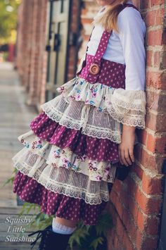 Timeless Treasure Skirt is a high-waisted suspender skirt featuring a fixed waistband with an exposed zipper closure, button front straps, a tiered ruffle skirt with an above-the-knee hem. Create Kids Couture, Little Lizard, Suspender Skirt, Ruffle Skirt, Closure, Zipper, Button, Skirts, Fashion