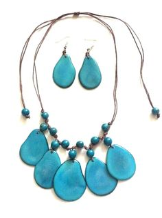 The jungle necklace on blue made of tagua nut slices and acai berries ( earrings include)