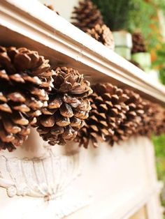Give your mantel north-woods charm with a pinecone garland. To make, cinch wire around the stem end of each cone, then use thumbtacks to attach the strand to the mantel.