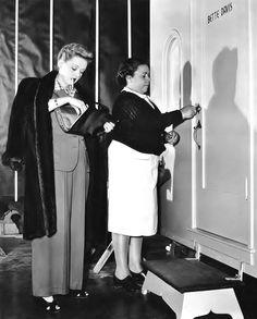 """Miss Davis arrives on the Warner Bros. set of """"Now Voyager"""", 1942."""