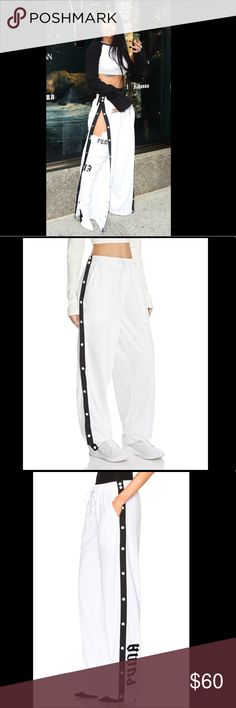 Puma Fenty by Rihanna Tearaway Track pants Fenty by Rihanna Puma Tearaway Track pants  Sold out everywhere Sizes: XS(2) S(1) M(2) Brand new, never worn Retail price $150 Selling for $60 Willing to negotiate Puma Pants Track Pants & Joggers