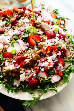 This loaded strawberry salad with balsamic vinaigrette is a showstopper! It's refreshing and perfect for summertime.