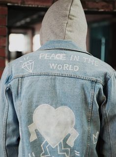 writing on the denim jacket and hoodie.