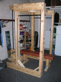 Homemade power rack made out of wood and pipe.