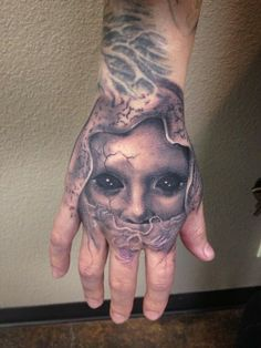 Creepy hand tattoo by Carl Grace