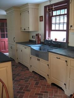 Love this kitchen by Timeless Kitchen Design (Kevin Ritter). The floors are thin brick from Inglenook Tile Design, and the soapstone sink and counters from Bucks County Soapstone. http://www.inglenookbricktile.com/index.html