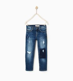 JEANS WITH CONTRAST AND RIPS