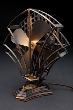 The coolest old Art Deco style electric fan - the metal blades really moved the air around.floor lamp?