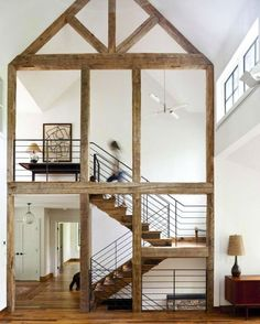 Outlined with reclaimed wood, this modern barn conversion sits on the waterfront of a Masachussetts lake and provides a tranquil getaway from the urban bustle. The stunning contrast of the white walls and wooden frame, including the antique oak staircase, is an unforgettable blend of rustic and refined. #architecture #design #interiors #interiordesign #renovation... - Interior Design Ideas, Interior Decor and Designs, Home Design Inspiration, Room Design Ideas, Interior Decorating, Furniture…