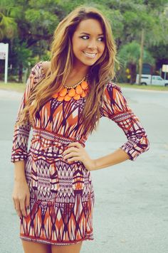 Fun print with a statement necklace.