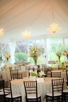 Love the dark brown chairs and of course... tent reception!