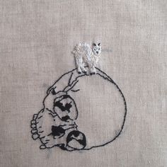Hand embroidery on natural linen.