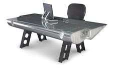 How about a desk made from vintage airplane parts? Lots of choices. This photos shows a C-119 Flap Airplane Desk.