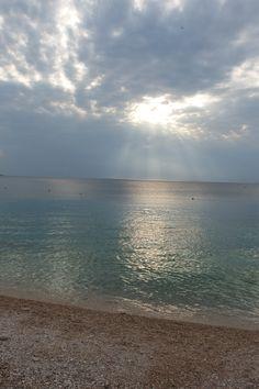 západ slnka za oblakmi