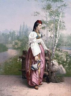 Painting of a Bosnian Muslim girl in traditional clothes This shows how covered women were meant to be. It also shows how refined and delicate the dress is, and the elegance of the Muslim golden age.