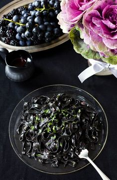Black Linguine with Kalamata OlivePesto:1 cup kalamata olives, rinsed and pitted  1/3 cup pine nuts  2 garlic cloves  1 cup fresh parsley, chopped  1 teaspoon lemon juice  1/4 cup extra virgin olive oil  2 tablespoons parmesan cheese, grated  1 pound black linguine (squid or cuttlefish ink pasta)  salt and pepper to taste