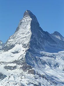 Walter Bonatti (cont.). In Switzerland, on the right side of the Matterhorn, in the shadow, is its north face.