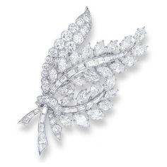 A DIAMOND BROOCH, BY VAN CLEEF & ARPELS   Designed as a marquise, brilliant and baguette-cut diamond foliate spray, mounted in platinum, 7.1 cm long    Signed VCA for Van Cleef & Arpels, No. 33426
