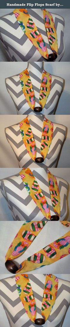 Handmade Flip Flops Scarf by Ladies Fashion Collars Unique No Tie Design with Wood Brown Bead One Size Fits All Flip Flops on Yellow Background Handmade USA. Handmade Ladies Fashion Collars Fabric Scarf Necklace Colorful Flip Flops, pink, green, orange, gray, on a yellow Background in a Cotton Fabric with Brown Wood Bead. One Size Fits All; Simply Slip it Over Your Head; Lightweight Only 1 Ounce, Bead holds decorative fabric scarf in place, complementing any neckline. No Tie; No Fuss; No...