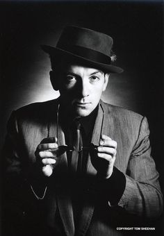 Elvis Costello by Tom Sheehan- I would never recognize him...