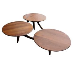 """Molecule"" teak coffee table circa 1950's USA 1950's A really wonderful triple-platter teak coffee table circa 1950's. Fantastic construction...great finish. Each platter has an ample 20"" diameter rendering the table as not just great looking but also really usable. Measurements height: 13"" depth: 36"" width/length: 52 1/2"" diameter: 20"" Specifications Number of items: 1 Materials/Techniques: teak Creator: unknown"