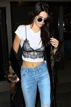 Kendall Jenner wearing a black lace bralet over a white T-shirt = summer outfit goals.
