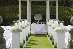 Exclusively Weddings Wedding Flowers up the aisle, outside ceremony at Rhinefield House  Photo courtesy of Martin Bell