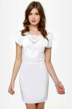 White with lace detailing on the neckline, I wish I had more reasons to wear dresses