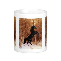 A friesian in winter snow coffee mug