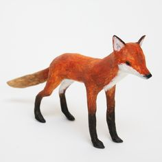 This slender little Fox is made entirely from newspaper. He is painted with acrylic paint with additional texture and detail added with pencil cray...