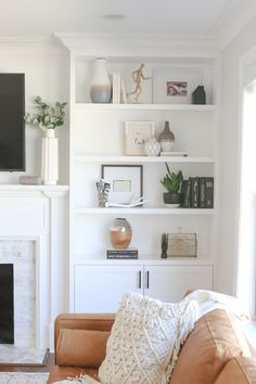 """We often get asked about the """"formula"""" we use for decorating our built-in shelves. The answer is that we don't have a secret method but we do have a few guidelines that we use to decorate built-in shelves and just about any shelf space in our homes. Here are our tips! #styling #shelves #builtins #accessories #homedecor"""