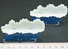 Set of 2 multi-part Rain Squall markers featuring fluorescent blue rain with translucent white clouds on a wide base. Each Rain Squall marker measures 77mm wide by 45mm high when assembled. You can use your Rain Squall markers to represent storm fronts and rough seas. These markers complement our range of smoke screen markers, and can be used with them to show rain and fog conditions. We recommend gluing these parts together.