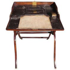 English mahogany folding campaign desk with fitted leather interior consisting of document pouch,original ink well, quill box, writing surface, and terminating on supported x framed legs. Folding Furniture, Antique Furniture, Modern Furniture, Campaign Desk, Campaign Furniture, Century Cabinets, British Traditions, Sideboard Cabinet, Home Comforts