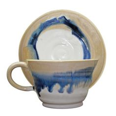 Turner Inspired Ceramic Cup and Saucer. The fluid blue and brown pattern on this curvaceous ceramic cup and saucer was created by Laura De Benedetti to celebrate the National Gallery's 2012 Turner Inspired: In the Light of Claude exhibition. The two artists' love for the sea and the luminosity of weather conditions have been translated into ceramic art. Each cup and saucer is hand-thrown and has a unique decoration, which means no two designs are exactly the same. Truly wonderful…