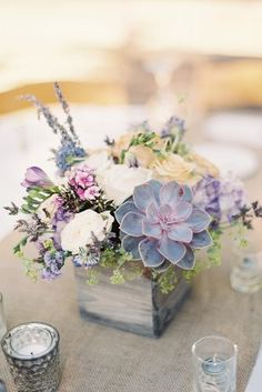 rustic wedding centerpieces bouquet of wildflowers with white roses and succulents in a wooden box sposto photography