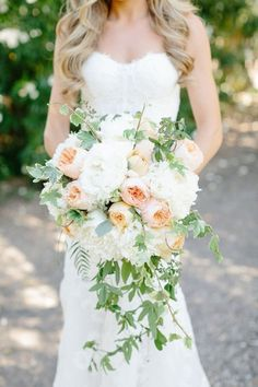 Need a bridal bouquet inspiration for your wedding? Consider the white bridal bouquet. While we love scoping out all of the innovative floral designs that are out there, a white bouquet will forever be timeless. Bouquet En Cascade, Cascading Wedding Bouquets, Bride Bouquets, Wedding Flowers, Wedding Dresses, Trailing Bouquet, Bouquet Wedding, Peach Bouquet, Flower Bouquets