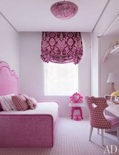 A lively children's bedroom with a pink theme | archdigest.com