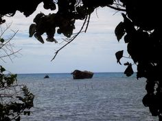 A shipwrecked hull in the harbour - Tonga's Abode Of Love - A walk around Nuku'alofa, taking in the sights of the capital of the Kingdom http://jouljet.blogspot.com/2014/09/tongas-abode-of-love.html #Tonga #travel #Pacific