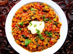 Red lentil dahl with spinach and curried yogurt