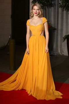 BAFTA Awards 2015 Red Carpet Fashion - Mustard yellow is on for the year of 2015 and Lea Seydoux knows just how to grab attention by refusing to show fear of bad luck in donning the gorgeous yellow Prada number.
