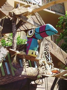 I live in a small beachcomber shack made from planks of driftwood and bamboo, where I daydream and create exotic objects of curiosity out of. Tiki Hut, Tiki Tiki, Hawaian Party, Tiki Bar Decor, Tiki Totem, Tiki Lounge, Tiki Mask, Driftwood Sculpture, Bird Quilt