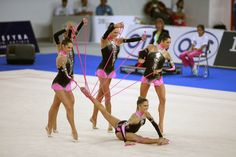 The Rhythmic group from Italy doing their five rope routine that they also performed in the 2008 Beijing Olympics. They are a very strong contender for the gold at the London Olympics! In group competition, apparel must have an identical cut and color for all members. Photo by Tom Theobald-tomtheobald.com Italy Team, Beijing Olympics, Rhythmic Gymnastics, Cut And Color, Leotards, Competition, Ropes, Dancing, Sports