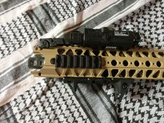 A LVOA rail (wire cutter by angry gun), an XTM handstop, MBUS flip ups, Noveske Low-pro gasblock and a Crusader compensator/muzzle brake. Color: WH Khaki Tropen by fosco Airsoft Gear, Wine Rack, Guns, Wire, Accessories, Color, Weapons Guns, Colour, Revolvers