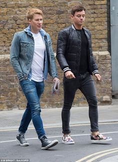Tom Daley, 22 pictured in London 2017 with husband Dustin Lance Black, 42