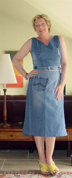 This dress is made up of 3 pairs of jeans which her son outgrew. Turned out very nice.