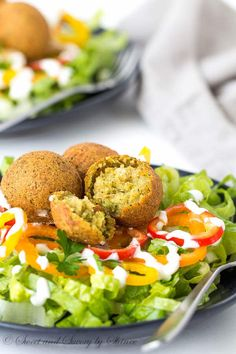 Simple satisfying salad, loaded with flavorful falafel balls and smothered with tangy Greek yogurt dressing. Customize yours with your favorite leafy greens and toppings. It's delicious summer lunch!