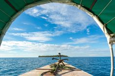 The anchor of a small boat-The anchor of a small boat pointing in the direction of Changuu Islands which is located on the Indian Ocean near Zanzibar, Tanzania