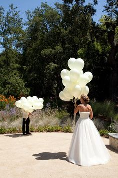 "Best ""first look"" idea I've seen - hold a bunch of helium balloons in front of your faces, walk towards each other, and then release them!"